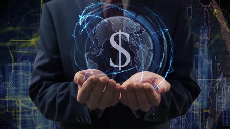 waluta : Male hands activate a conceptual holographic text Sign USD. Businessman in a suit with a hologram of planet Earth on a background of a futuristic wireframe city