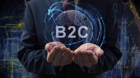 çözümler : Male hands activate a conceptual holographic text B2C. Businessman in a suit with a hologram of planet Earth on a background of a futuristic wireframe city Stok Video