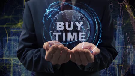 waluta : Male hands activate a conceptual holographic text Buy time. Businessman in a suit with a hologram of planet Earth on a background of a futuristic wireframe city