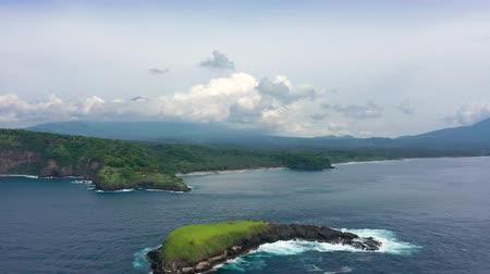 virgin forest : Small island in the ocean Aerial Stock Footage