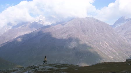 A man walks along the fantastic scenery in the Himalayas Stock Footage