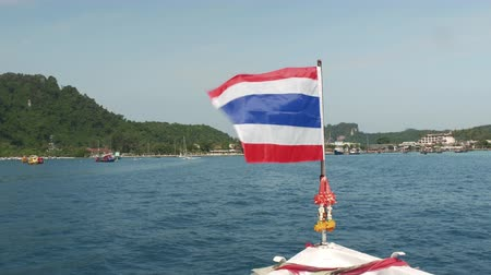 Flag of Thailand on the bow of the boat Stock Footage