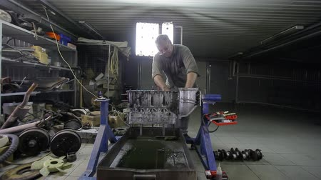 Works on repair of the engine block of the car
