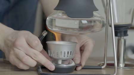 brew coffee : Syphon vacuum coffee maker Stir device Stock Footage