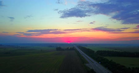 július : Summer Sunset Evening Above road and Field Landscape. drone flight