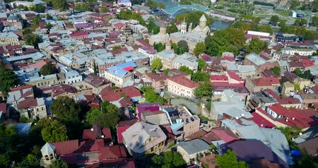 gürcü : Aerial View Of Center Of Tbilisi, bridge of peace, Meidan, Rike park. Drone flight Stok Video