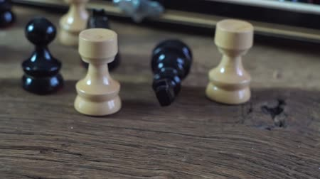 piskopos : Wooden chess board and Pieces on old wooden board. Intelectual game.