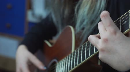 strum : Closeup of young womans hand, strumming the guitar