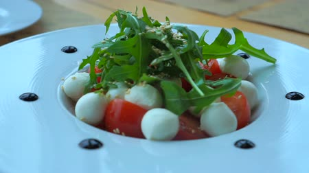 capers : caprese salad with mini mozzarella balls, tomatoes and capers Stock Footage