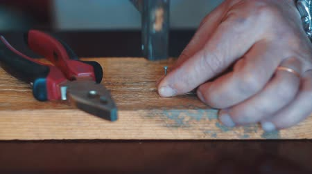 knotted : carpenter joining wooden planks using plain hammer and steel nails Stock Footage