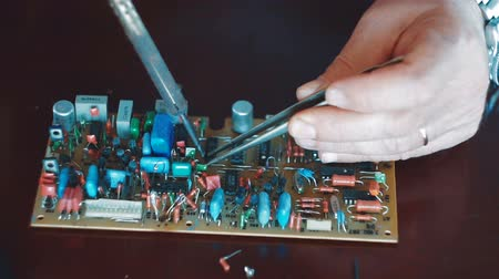 soldering iron : The craftsman manual soldering of electronic components Stock Footage