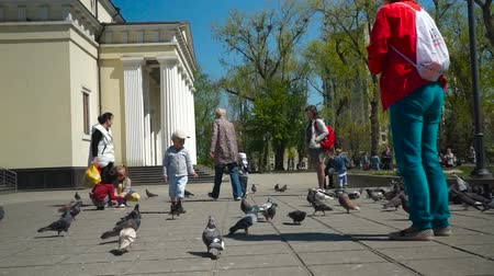 red square : People around Nativity Cathedral, Kishinev-Moldova, April 20, 2018. Kids and pigeons.