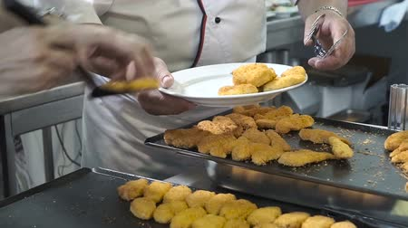 baking dishes : Chef puts fried Lake Ohrid to a plate.