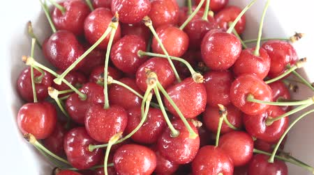 sweet cherry : Group of Ripe Juicy Red Cherry Rotates on the White Background.