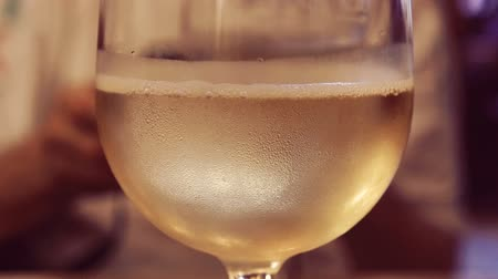 flexão : White vine poured in glass goblet, splash white backround.