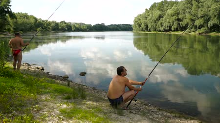 döküm : Fishing in river.A fisherman with a fishing rod on the river bank.