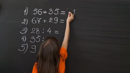 elmélet : Young Student Writing Complex Mathematical Formula Equation on the Blackboard.