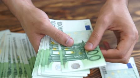 hundred : Man Counting Euro Banknotes Stock Footage