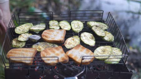 hot pot : man baked bread and vegetables on barbecue outdoor