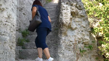 kelt : Woman Moving On The Old Stone Steps Of Ancient monastery in stone Stok Video