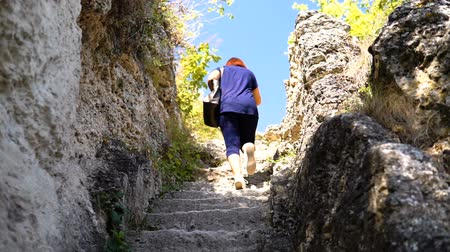 Woman Moving On The Old Stone Steps Of Ancient monastery in stone Dostupné videozáznamy