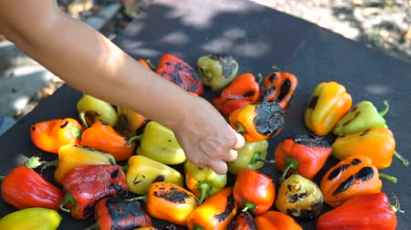 Red and yellow sweet pepper cooking on the grill