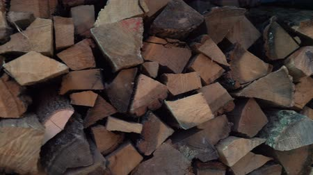 brown bark : Stacks of firewood. Pile of firewood prepared for fireplace. Firewood background.