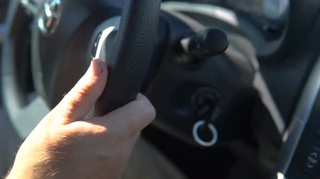 Driving a car on a snowed route. Male hands on steering wheel. close Up. Dostupné videozáznamy