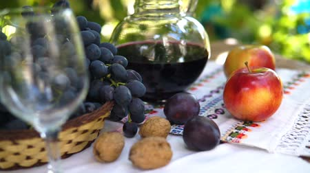 red wine : Still life with basket Autumn fruits, Steadicam shot. Stock Footage
