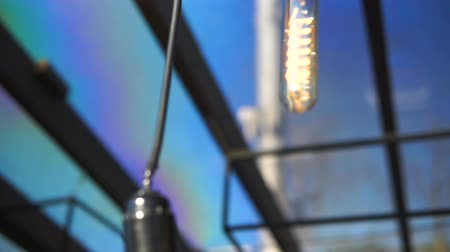 getting electricity : Light bulbs garland close up. Stock Footage