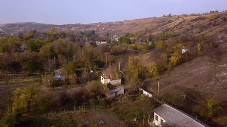 bird ecology : Camera flight over small village. Autumn landscape. Moldavian republic. Europe. Stock Footage