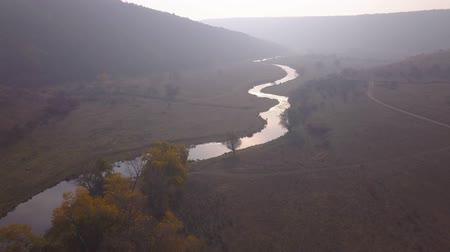 ekili : Beautiful sunrisw over river in rural area. Fog over small river. Mountains landscape. Stok Video