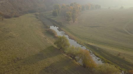 small height : Beautiful sunrisw over river in rural area. Fog over small river. Mountains landscape. Stock Footage