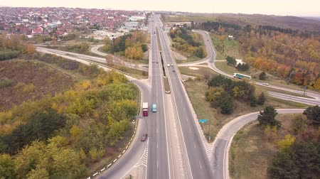 autobahn : 4K aerial view flight over highway. Road vehicles daily traffic cars are moving in both directions view from above Stock Footage