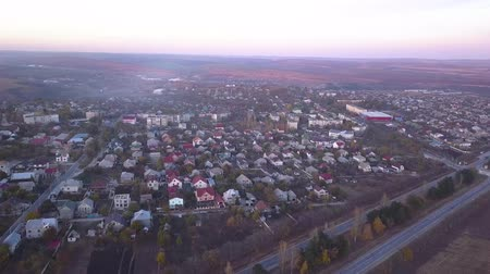 peyzajlı : aerial flying shot over suburban area, streets, and houses