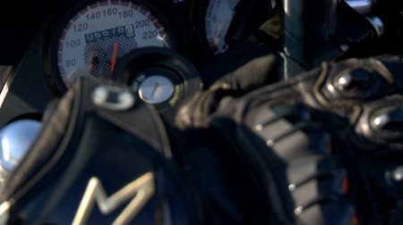 torpedo : Closeup of a motorcycle biker, which are a stylish biker gloves next to the speedometer Stock Footage