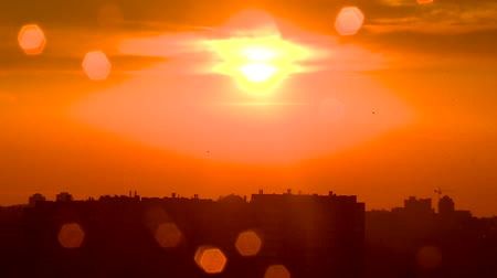 after fire : View of the city at sunset. The sky is in red after the rain Stock Footage