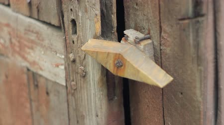safeness : The old wooden door to the old house with a wooden latch