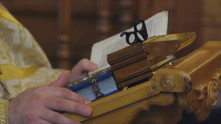 christening : The Sacrament of Baptism in the Orthodox Church. Close-up of a priest reading the Gospel