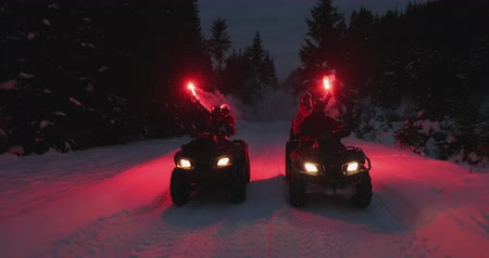 quad hd : Trip to quad bikes on the snow-covered mountains with flares in hand 4K Ultra HD