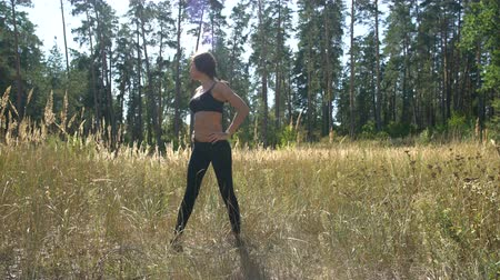 Beautiful girl performs morning exercises in the open air, sports girl, health Stok Video