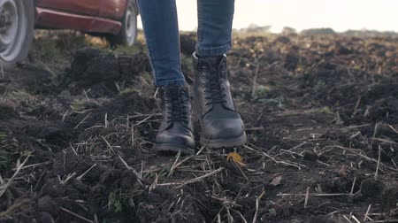 A girl is walking along the field, womens shoes Stok Video