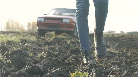 faint : Girl threw the car in the field, A girl is walking along the field,womens shoes