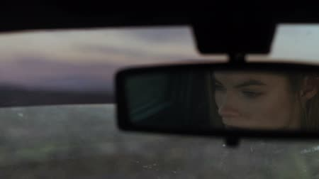 меланхолия : The girls eyes in the cars rear view mirror, depression and despair