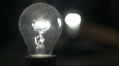 hallucination : The light bulb pulsates against a black background, the pulsation of incandescent light, the dimmer