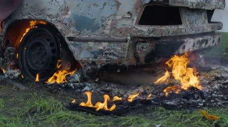 Burning car tires, the car burns a wheel, a completely burnt out car