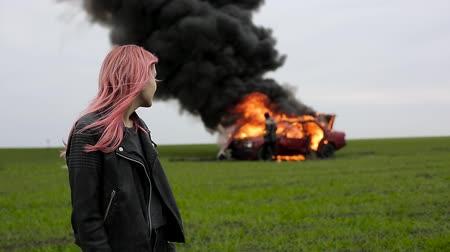 feminist : Young beautiful girl on the background of an exploding car, goth, emo girl
