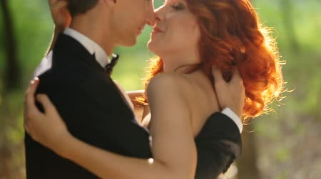 redhead suit : bride and groom to kiss Stock Footage