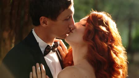 redhead suit : bride and groom kissing Stock Footage