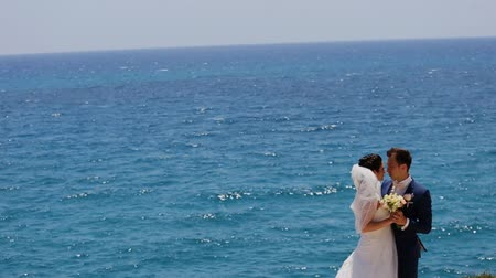 ciprus : married hugging on a background the sea